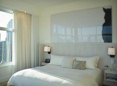 Striking David Kassman piece in the Penthouse Loft bedroom at The James New York