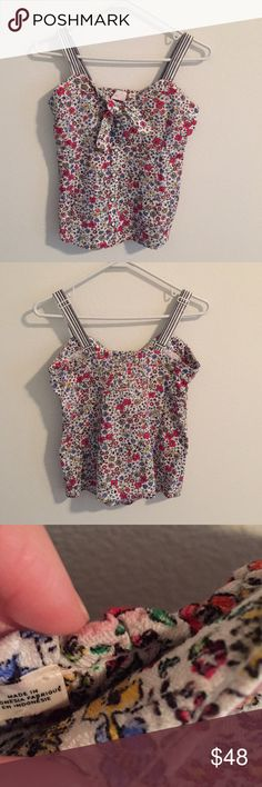 Anthropologie Bowed Bouquet Tank Adorable floral tank with button front and thick adjustable striped straps. Top has some slight red discoloration which is not obvious against the floral print. See pictures 3 and 4 for some closeups. Anthropologie Tops Tank Tops