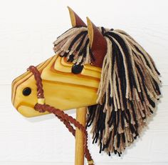 Stick Horse - Hobby Horse - Waldorf Toy - Personalized Wooden Toy - Brown/Black/Tan - Hill Country Woodcraft by hcwoodcraft on Etsy https://www.etsy.com/listing/106770280/stick-horse-hobby-horse-waldorf-toy