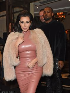 Nice and cosy: The reality star and her rapper beau were seen leaving the Dorchester Hotel and Kim was hard to miss as she wrapped up in a large fur jacket