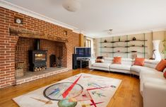 #Sittingroom featuring an outstanding #Inglenook fireplace with a wood-burner, #oak flooring, windows to both front and rear aspect and French doors opening to the outside terrace. In Moulton Road, Kentford