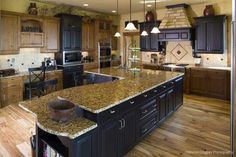 Huge kitchen island with seating and a cookbook shelf. Kemper Hill Mountain Home Kitchen from houseplansandmore.com