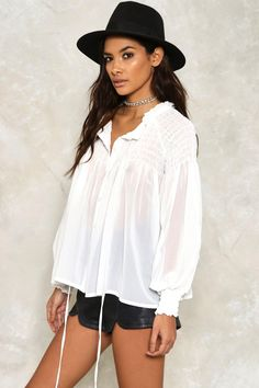 Say hi to the tie. Wrap yourself up in sheer style this season by adding Amy Shirred Tie Neck Blouse to your closet, a contemporary design to lust after with its cropped sleeves, tie neck and on-trend loose fit.