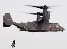 Bell Helicopter CV-22 Osprey hoisting US Navy SEALs - Cargo VTOL Aircraft