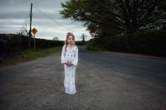 Photograph by Birte Kaufmann | A young girl poses after her first Communion in County Carlow. (20 of 20)   http://www.nationalgeographic.com/photography/proof/2016/08/irish-travellers-uphold-the-traditions-of-a-bygone-world/    http://www.birtekaufmann.de/index.php?/the-travellers/the-travellers/