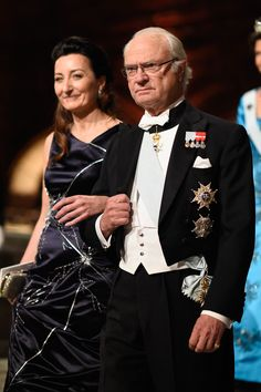 Professor May-Britt Moser and King Carl XVI Gustaf of Sweden attend the Nobel Prize Banquet 2014 at Concert Hall on December 10, 2014 in Stockholm, Sweden.