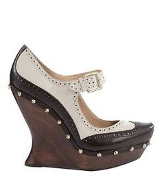 McQ      McQ (Alexander McQueen) Bone Studded Mary Jane Wedge  Studded black leather Mary Janes with gold buckle strap, brogue details and wooden wedge.