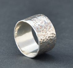 A contemporary handmade wide silver ring with a textured hammered finish that was inspired by the natural beauty of tree bark. This stylish 10 mm wide made to order Hammered Sterling Silver band is created using 1 mm thic. Silver Rings Handmade, Sterling Silver Rings, Silver Jewelry, Gifts For Him, Tree Bark, Rings For Men, Band, Natural Beauty, Strength