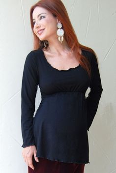 The long sleeve maternity scoop top is one of our most popular item  The top is made from a very soft and cozy rayon modal fabric which means you will not want to take it off      Babydoll style cutElastic at waist line for slimming fitLettuce edging at hemsRayonPolySpandexMachine wash cold, tumble dry  The hems around the  neckline, sleeves, and bottom are sewn in lettuce edging and elastic  ruching is added under the bustline to give extra interest to this  staple te