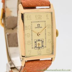 1926 Vintage Omega Art Deco 14k Yellow Gold watch with Gold Dial with Raised Arabic Numbers. Triple Signed. Case Very Good Case Original, Case Dimensions: 26mm x 38mm lug to lug, Art Deco Leaf Pattern