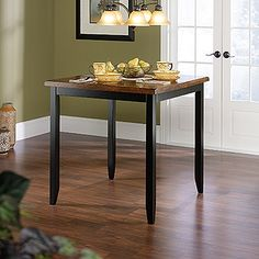 Solid wood construction. 1 1/2 in. thick, split table top. Tapered leg design. Soft edges. Estate Black Comp. finish.