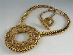 In 2009 my Golden Circle Necklace was featured in Marcia DeCoster's Beaded Opulence Book. To list it, I had to put a price on it. Circle Necklace, Drop Necklace, Beaded Jewelry, Handmade Jewelry, Beaded Necklaces, Golden Circle, Necklace Tutorial, Bead Weaving, Jewelery
