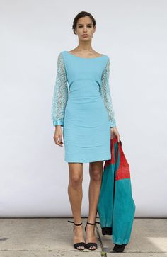Beautifully fitted 1960s mini dress in luminous turquoise blue with geometric lace sleeves (buttoned at the cuffs) and zipper closure on the back.