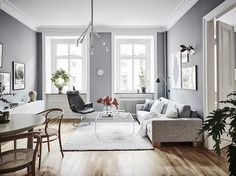 I like the combination of the cool grey walls with the warm wooden flooring in this apartment. The white linen bedding in the bedroom makes this room look very fresh and the natural Thonet dining chairs in the living room … Continue reading → Home Decor Bedroom, Living Room Decor, Bedroom Balcony, Gray Interior, Interior Design, Interior Ideas, White Washed Floors, Bedroom Minimalist, Gravity Home