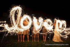 Love love LOVE this!!! Painting with light photo, using fun sparklers at wedding reception.