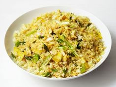 Fried rice is the ultimate pantry-raid dish: throw in whatever spices you have lying around for a tasty meal. We use curry powder in this version.