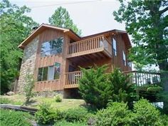 Gatlinburg, TN: Enjoy the wrap-around view in this unique mountain home. Glass enclosed game room features ceramic tile and comfy wicker furniture for playing card ga...