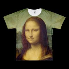 """Mona Short Sleeve T Shirt. Regarded by some as """"the greatest masterpiece of all time"""" When rapper Jay-Z compared her beauty to that of his wife singer/entertainer Beyoncé, he was not the first recording artist to do so. In fact in 1988 rapper Slick Rick made an entire song about her and so did Nat King Cole way back in 1950. Beauty inspires beauty, art inspires art and so forth and so on. This piece represents the genius of creation and all of its greatness.  Printed…"""