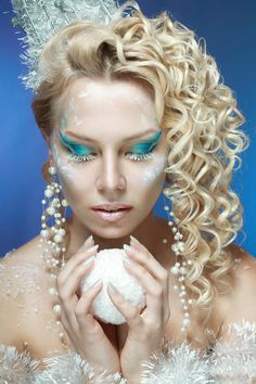 snow-queen - ce-queen. Young woman in creative image with silver blue artistic make-up and perfect hairstyle.