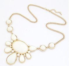 This super trendy white gems/jewels gold chain necklace will make a statement of any outfit, and is easy to match! Chic bubble necklaces are right on trend now, and the white gives it a very pretty chic feeling. Very nice quality! Pair with plain shirts and tank tops for an extra special touch.  Visit the store! http://stores.ebay.com/triedandtrendy/