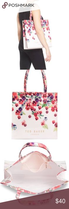 """Ted Baker Large Maycon Tote with Pansy Flowers Durable and Cute this is the perfect little bag for everyday. This is a Ted Baker Large Maycon tote NWT. Details:  PVC approx. 8"""" handle drop  approx. size 14.5""""H X14.5""""W X4.5""""D Please let me know if you have any questions.  Happy Shopping!! Ted Baker Bags Totes"""