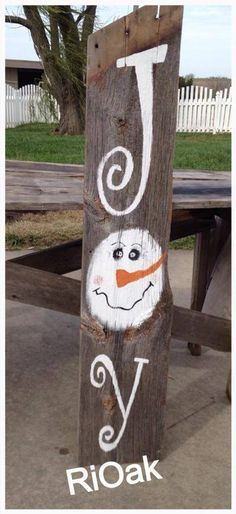 Joy, snowman, hand painted on barn wood. Great to decorate your porch for Christmas right through the winter!