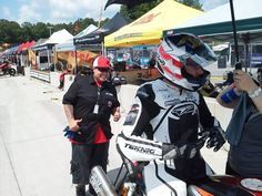 Veterans Empowered Through Motorsports crew member Brittany HustleHarder Perez with Paul James and the James Gang/Hoban Brothers Racing XR1200 during Saturday morning practice at Barber Motorsports Park in AMA Pro Road Racing Vance & Hines Harley-Davidson road racing.