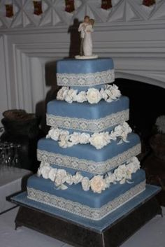 Wedgewood blue wedding cake with handmade roses, David Austin style roses and orchids.