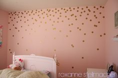 Another example of a pattern over even spacing with polka dots... Step-by-step DIY gold polka dot walls!