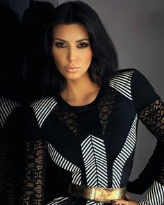 Kim Kardashian Great details in this dress.  The gold accent belt polishes off the look.