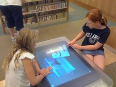 Tech-media-tainment: Microsoft Surface computer entertains young library patrons in Darien, Conn.