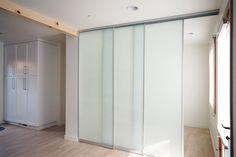 translucent sliding wall system provides privacy + light