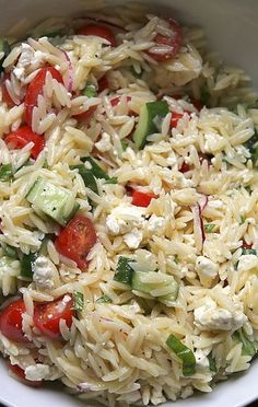 Greek Pasta Salad 5 cups cooked orzo pasta 2 cups de-seeded and coarsely chopped English Cucumbers 2 cups halved cherry tomatoes 1 heaping cup crumbled feta cheese 1/2 cup thinly sliced purple onion 1/3 cup chopped fresh basil More