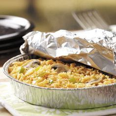 Rice on the Grill Recipe -My husband loves to barbecue, so when it's hot outside, we do entire meals on the grill. Since our kids love rice, we often include this tangy side dish as part of the menu. —Shirley Hopkins, Olds, Alberta