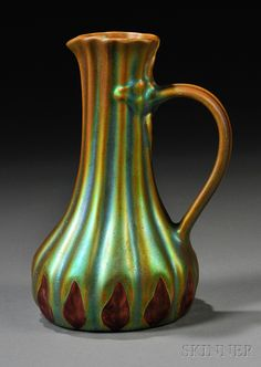 Art Nouveau Zsolnay Pitcher  Art pottery  Hungary, c. 1900  Eosin green and red glaze on ribbed organic form, round factory mark and impressed 5585, base rim glaze nick, ht. 6 in.