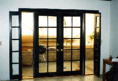 """This is a great way to replace a sliding glass patio door. Shown here is a 8' french door, two 30"""" 10 lite french doors and two 12"""" opening sidelites. The sidelites have screens on the exterior; this is a very convenient and a attractive way to get ventilation with out a screen door over the french doors."""