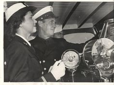 1942- U.S. WAVE officer tries her hand at running a Coast Guard cutter on Lake Michigan off Chicago.