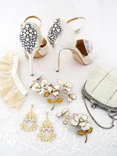Wedding Shoes. Bridal Jewelry. Hair Accessories & so much more. Discover Boho Chic bridal accessories with a vintage vibe at Perfect Details. Let us help you find the ultimate details to define your wedding day style. Shown: Badgley Mischka Wedding Shoes, Paris by Debra Moreland Hair Combs & Earrings, Moyna Handbag & our own garter.
