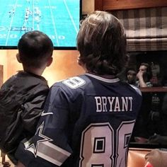 Jared and Shep watching the Cowboys game. His reflection in the window says it's all