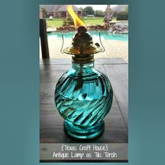 {Texas Craft House} Use an old antique oil lamp as a backyard patio table tiki torch or candle