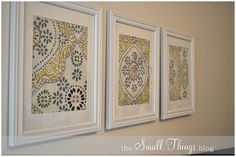 Cheap DIY wall art. She framed fabric napkins, positioning different areas of the napkins pattern. So cheap & easy, you could change these seasonally. Or even use paper napkins in a smaller frame.