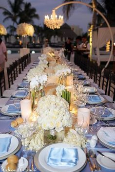 We're loving this stunning table scape of beautiful white, green and cream tones with candles at Secrets Maroma Beach!