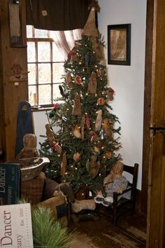 Primitive country Christmas tree with cute handmade rustic and early ornaments. ♥
