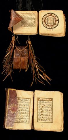 Africa | Miniature koran and two further islamic devotions from the Hausa people of Nigeria | Loose sheets (h: 10 cm), firmly tied up in a leather case with punched ornaments, attached to leather strings with tassels . Loose sheets (h: 11 cm) in square envelope-like leather case without lace fastening. Brown leather cover, the pages originally bind like a book, letter in gold coloured cartridges, delicate painted polychrome ornaments. | Collected in situ, 1974
