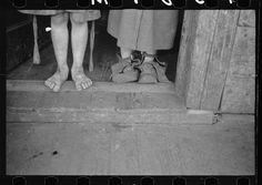 Feet of children of George Blizzard, Coal miner, Kempton, West Virginia.  Vachon, John, 1914-1975, photographer.  1939 May.