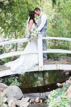 Wedding couple, on the bridge over the Koi Pond. Camron & Meghann Erickson's gorgeous early autumn wedding at Lithia Springs Resort, September 2015