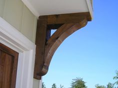 Check out our cedar corbel selection for the very best in unique or custom, handmade pieces from our home & living shops. Corbels Exterior, Craftsman Exterior, Modern Farmhouse Exterior, Craftsman Style, Garage Pergola, Patio Roof, Pergola Plans, Pergola Ideas, Pergola Kits