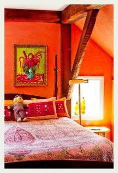 I think the little guy on the bed makes the room. =0) Boho joy.: