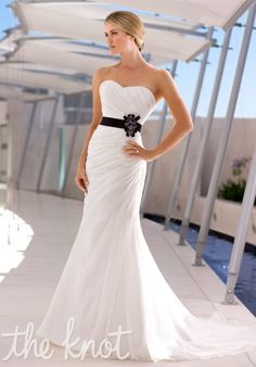 Gown features detachable belt.  Also creates an illusion of a smaller waist.    Silhouette: Sheath  Neckline: Sweetheart  Gown Length: Floor  Train Style: Attached  Train Length: Chapel  Fabric: Soft Organza, Dolce Satin  Color: White or Ivory