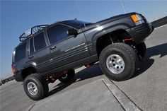 Highly desirable Jeep ZJ Grand Cherokee Limited Edition vehicle. 1998 is the only production year where Chrysler Jeep offered the 5.9-liter Magnum V8 in a se...